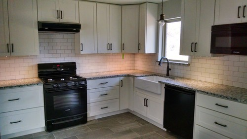 POLL White Cabinets Black Appliances Granite And ORB Cabinet Pulls