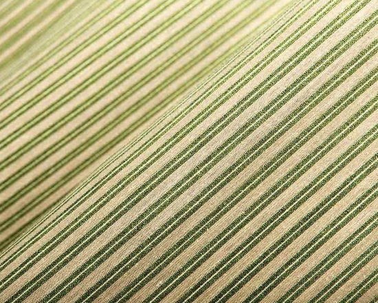 Arizona Stripe Upholstery Fabric in Agave - Arizona Stripe in Agave is a green stripe upholstery fabric with a contemporary feel. The slight sheen catches light in a unique way that is perfect for upholstering sofas, chairs, or ottomans. This sophisticated fabric is perfect for traditional or transitional interior designs. American made from a blend of 47% cotton, 31% nylon, 15% linen, and 7% polyester. This fabric passes Wyzenbeek 50,000 double rubs, Calif Bulletin #117, UFAC, and NFPA 260 Class I. Cleaning code: WS. This fabric meets or exceeds ACT standards for upholstery use. Stripe woven selvage to selvage. Repeat: approximately 7/16″ v; Width: 54″