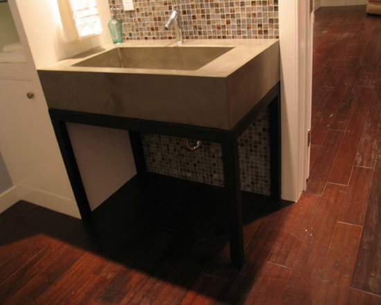 "Concrete Bathrooms - Concrete ramp sink with Steel base 6"" drop front"