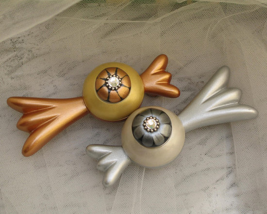 "Susan Goldstick, Inc. - Bundle Tiki Cabinet Pulls - Bundle tiki pulls are  4"" w with 3"" hole span,  Cast resin and hand sculpted the pulls are available in amber brown and pale yellow and silver and white. Both have crystal accents,  Coated with durable varnish for use in kitchens and baths, the Bundle Tiki pulls can be coordinated with matching knobs 1.5"" diameter."