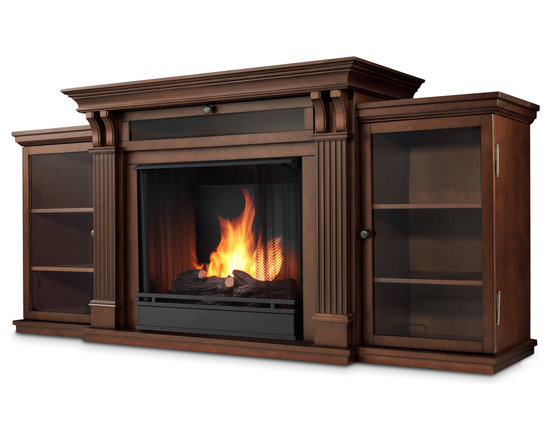 Dark Espresso Ashley Gel Fuel Fireplace & Entertainment Unit - Based on a best selling favorite, the Ashley Entertainment Mantel features ample storage thanks to a drop down center glass door and dual side cabinets. Capable of safely supporting a television of 100 lbs. or less while adjustable shelving accommodate most electronics and other objects. The hand-painted log set and bright crackling flame add to the realistic look of this Real Flame Gel Fuel Fireplace. Uses 3 - 13oz. cans of Real Flame Gel Fuel. Available in Dark Walnut and Dark Espresso finishes.