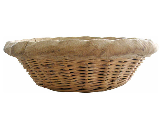 Round Wicker Bakers Bread Basket - Round wicker basket used by french bakers in the early 1900s for baking. The basket is lined with the original linen which shows the years of enduring the heat (the inner linen is much darker also a sign of use).