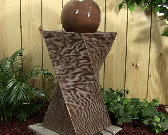 Outdoor Classics - Spiral Tower with Ball Fountain - Many clients have used multiple fountains like this to act as pillars for the entrance to their home.  It not only adds some class, but also some interesting focal points to the front of the home.