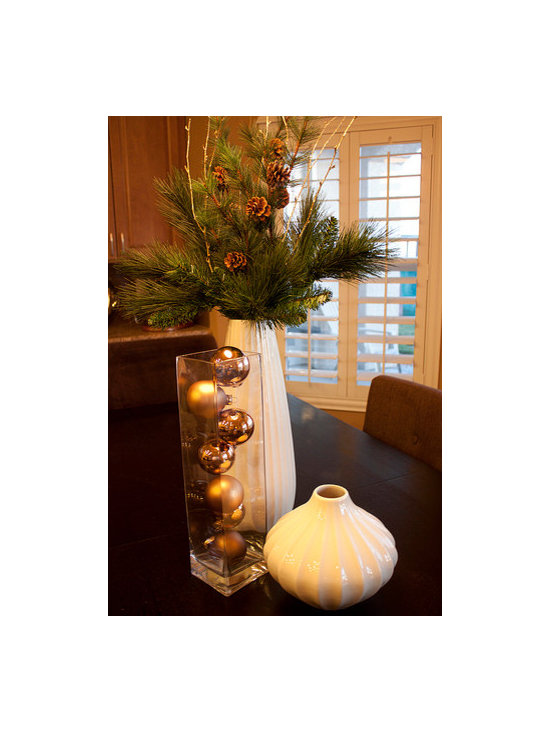 Mid-Century Christmas - A modern holiday table vignette adds height and drama to the room.