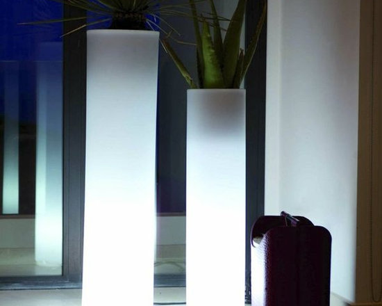 Round Tower Illuminated Outdoor Planter - This illuminated outdoor planter is available with LED lighting in multiple colors or a style with a fluorescent bulb that displays only white light.