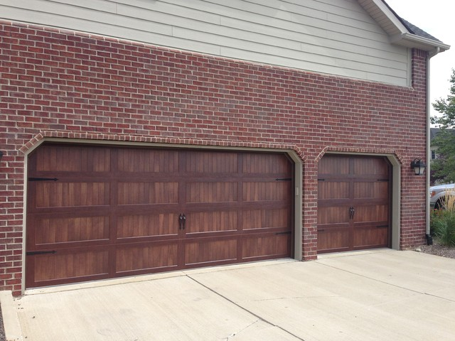 Faux wood garage doors traditional garage and shed for Fake wood garage doors