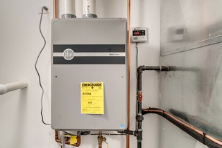 a tankless water heater can be part of a home renovation, to free up needed space