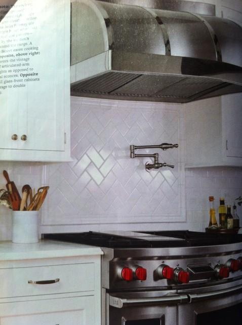 white subway tile backsplash in herringbone pattern for
