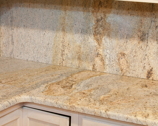 Leathered Kashmir Gold Granite - Kashmir Gold Granite with a leathered finish (also sometimes spelled lethered granite). Leathered granite is like a matte finish with a bit more texture than honed finish , which is also matte in shine level.