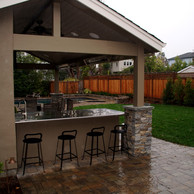 BBQ counter, pool house and paver patio traditional-patio
