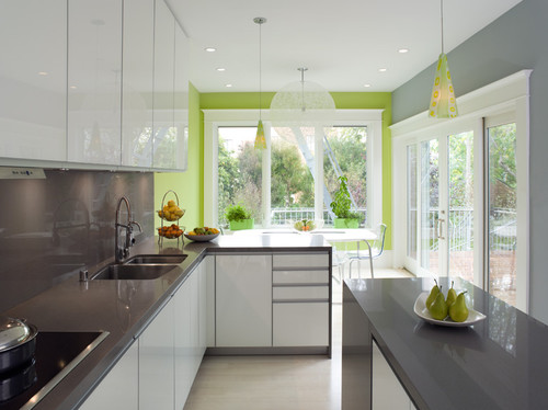A white and gray neutral kitchen with a bright chartreuse/lime green accent wall.
