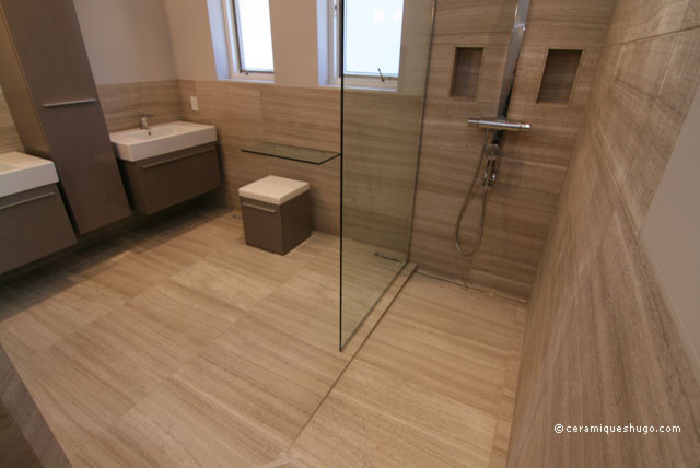 Bathroom in natural stone with a curbless shower modern montreal