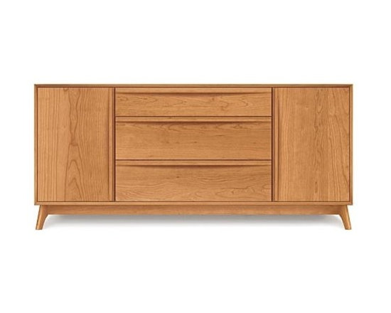 Copeland Furniture - Catalina Cherry Three-Drawer Buffet with Flanked Doors | Copeland Furniture - Made in Vermont by Copeland Furniture.Suggestive of the works of America's Mid-Century Modern designers, the Catalina Cherry Three-Drawer Buffet with Flanked Doors reflects the style's sense of hope and the promise of an ideal future. This modernist buffet features a central three-drawer cabinet flanked by two outward opening doors. Drawers and doors feature sleek pulls and soft-close (self closing) hardware. A designated silverware drawer keeps silver sorted and protected with Guardian Anti Tarnish lining and cloth. Hand-crafted with impeccable quality and attention to detail, this buffet will provide generations of use and enjoyment. Copeland Furniture uses sustainably harvested hardwoods from the American Northern Forest. All lumber used by Copeland Furniture comes from within 500 miles of their factory in Vermont, thus reducing fossil fuel consumption and carbon dioxide emissions from transportation. The environmental values of preservation and stewardship are reflected in every piece of furniture produced by Copeland Furniture. Product Features:  Three-drawers and two storage cabinets Integrated drawer and door pulls Soft-close (self-closing) hardware on drawers and doors English dovetail joinery drawers Fully finished drawer interiors Designated separated silverware drawer Adjustable cabinet shelves Silverware drawer with Guardian Anti Tarnish lining and cloth Compatible with the Optional Catalina Cherry Hutch (sold separately) Made in the U.S.A. of solid cherry wood