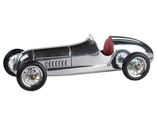 """Inviting Home - Silberpfeil Desk Racer with Red Seat - Silberpfeil racecar model with red seat 12-1/8"""" x 5-1/8"""" x 3-5/8""""H The 1930s saw the rise of hand built model racecars known as Spindizzies or tether cars. Miniature racecars built by hobbyists zoomed around banked wooden tracks at speeds approaching 150 miles per hour. Resembling the full-size racers of their day several Spindizzies competed at once tethered by cables to a central pole. Powered by model airplane engines spindizzies raced against the clock. Incredibly detailed and aerodynamic these miniature racecars were beyond toys; they were pieces of art representative of the best pioneering technology of the era."""