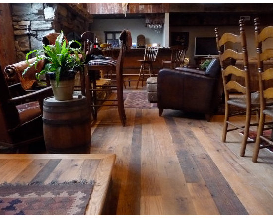 """Classic Oak Mix - This beautiful Reclaimed Classic Oak Mix flooring adds a distinctive element of character and class to any room. Whether your decor is antique and rustic or modern and minimal, this floor brings out the best in your design. The wood's unique stress cracks and original saw marks, along with aging patina (surface color and sheen) are impossible to recreate using a """"new"""" flooring product."""