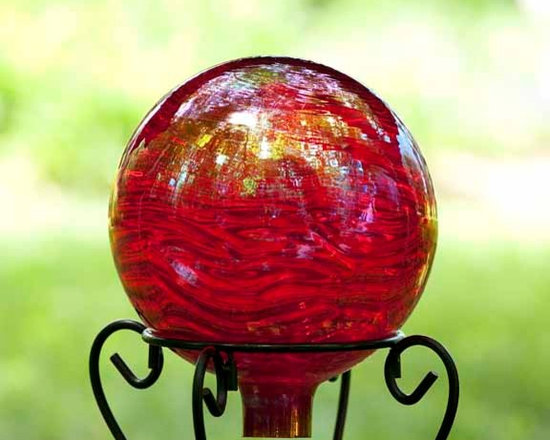 Outdoor Accents - Hand blown with 100% recycled glass. These gazing balls have a distinctive wave pattern and shimmer coating for added beauty.