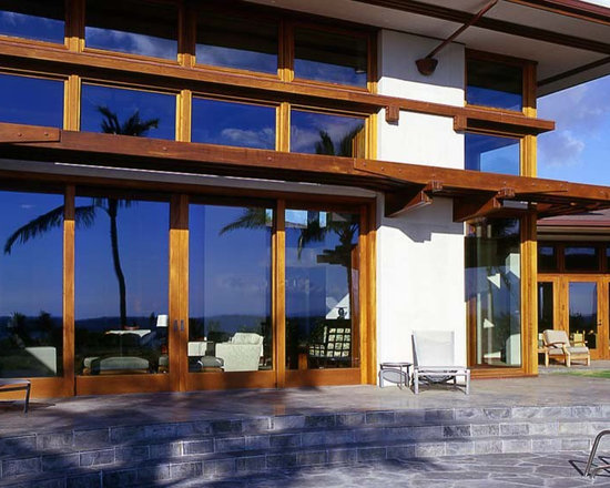 Quantum Windows & Doors - Quantum Windows & Doors | Roth Kimura Architects - Alvis Upitis Photography - This Hawaiian home is a magnificent showcase of Quantum's Euro Series windows and doors. Custom built from Sapele and Mahogany, the wood front entry features triple hung architectural windows that can be literally walked though as motorized hardware retracts each sash into hidden pockets in the ground. Quantum's engineers worked alongside Roth Kimura Architects to bring to life this homeowner's dreams of an island paradise.