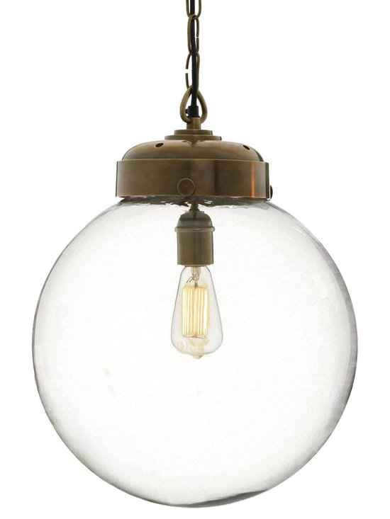 Arteriors Reeves Large Pendant - Transitional clear hand-blown glass orb topped with antique brass hardware adds a vintage feel to this contemporary pendant. Consider an antique style bulb to create a subtle glow while featuring various filament designs.