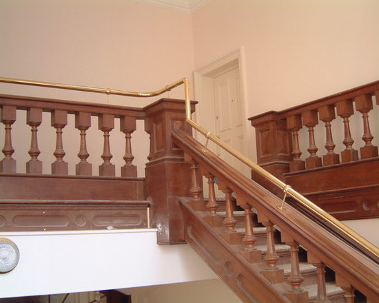 Ornate Balustrading - To ensure it conformed to british standards; this hand railing was designed to the top of the existing timber balustrade. This traditional balustrading is fabricated out of polished brass tube and installed at an old courthouse in Leeds, West Yorkshire.