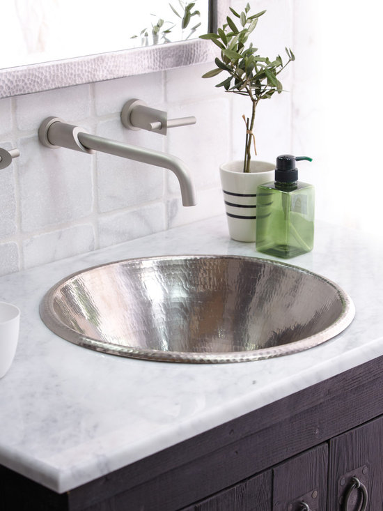 Cazo Copper Bath Sink in Brushed Nickel by Native Trails - Cazo copper sink from Native Trails is a distinct and versatile self-rimmed sink. Dropped in over the counter, Cazo's rolled rim and deep narrowing bowl subtly draw attention to the hand-hammered finish. Or flaunt Cazo's details as a vessel sink, and create a clean yet dramatic effect. Either mount choice provides a deep, unique bowl, beautiful in three finishes; Natural, Antique, and hand-dipped Brushed Nickel.