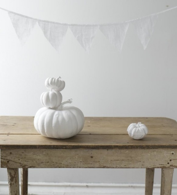Simple Painted White Pumpkin and farm table eclectic
