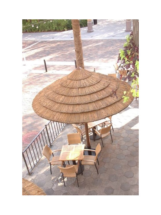 Thatch Umbrella - Natural - Natural thatch umbrellas can enhance any residential or commercial property by adding a tropical ambiance and upgrading an existing environment. The Thatch Panels allow the structures to effectively withstand wind, rain and sun providing  a durable and long-lasting alternative to the canvas umbrella. Thatch Panel umbrellas are great in windy climates as both the synthetic thatch panels and natural thatch panels use a clip design to lift up and down on the re-bar to accommodate wind uplift.