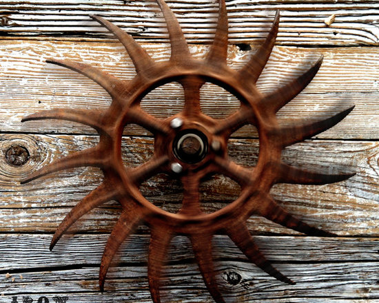 """Antique Industrial Gear Decor - Extra-dynamic old wheel with angry, curved claws of thick iron. Crusty, rusty patina to ensure you know it means business! Includes custom wall-mount bracket which allows wheel to actually spin beautifully. 19.5"""" diameter."""