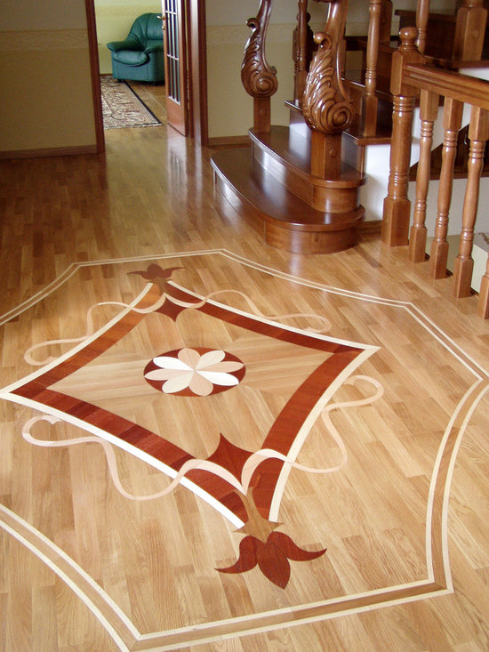Wood Inlay in the Entry - Wood floor medallion in Entry made as it's inlaid in the White Oak floor.