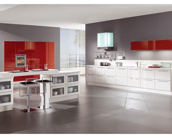 Modern kitchen with red and white high gloss cabinets - Large modern kitchen with glass front pullouts .