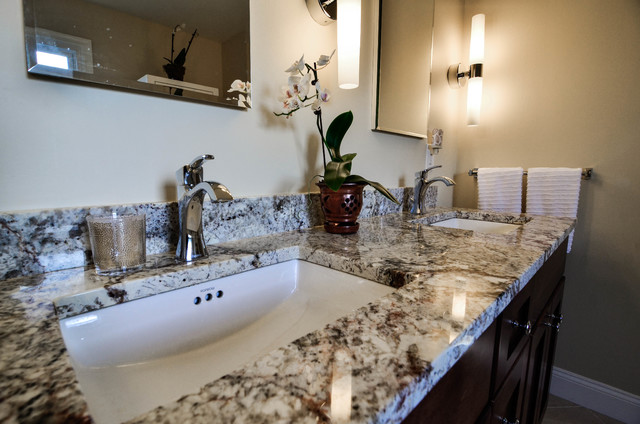 Black and white granite countertop with chrome fixtures - Transitional ...