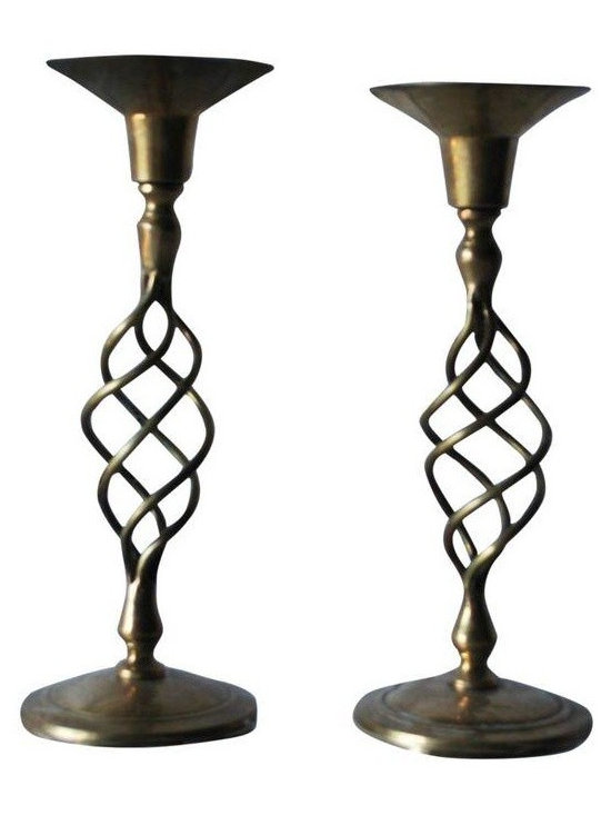 "Used Brass Barley Twist Spiral Candlesticks - A Pair - This pair of solid brass barley twist spiral candlesticks was made in India. They are in excellent condition and will look stunning amidst your Holiday tabletop. Note that one of the candlesticks is 1/4"" taller than the other.    Measures:  Width of Base- 5""  Height- 8.5"""