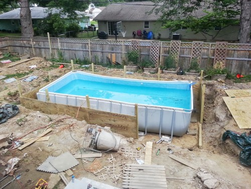 Deck surround overlay above ground pool for In ground pool surround ideas