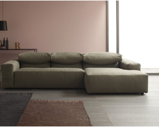 Eco Friendly Furnture and Lighting - CLOUD is a modern design look sofa for those wanting a product whose design and materials are all of proven quality, and for those looking for smart and certified eco-friendly products. Completely removable in fabric, CLOUD is a modular seating, that can be arranged in many different ways. Comfortable and elegant, it has a very original back cushions. Thanks to a patented system, cushions can be arranged in infinite ways: for relax or conversation, to read or to work at laptop. CLOUD is padded with a new generation microcellular foam (Limpha®) made from a compound delivered from removable plant sources, polyols, not from petroleum by product. Limpha® foams have high breathability which allows an excellent level of aeration, avoiding the formation of moulds, mites and bacteria.