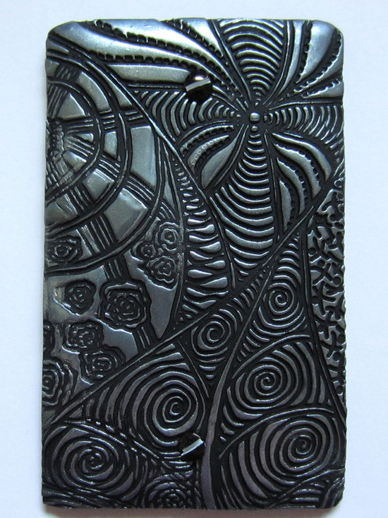 """general spaces - Why keep old, unused phone jack covers on your walls? They need to go. But you can`t just leave a gaping hole there. Use a beautifully textured ceramic cover to """"artify"""" that space. It`s the little touches..."""