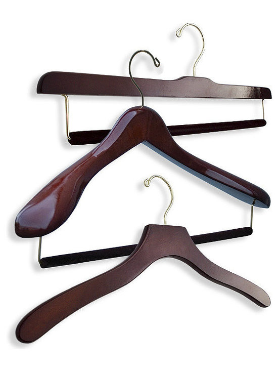 """Frontgate - Men's 40-pc. Executive Hanger Collection - Designed in collaboration with bespoke tailors. Available in 100% birch wood with Bubinga finish or 100% maple wood construction with satin finish. Available in up to four different widths (small, medium, large, extra-large) for optimal sizing (15-1/2"""", 17"""", 18-1/2"""", 20""""). Suit hangers feature 2-1/2"""" shoulder flare, offering up to five times more support than average hangers. Eliminates shoulder dimpling, which is caused when hangers do not extend all the way to the edge of the shoulder. Protect and extend the life of your most important wardrobe items with our Luxury Executive Men's Hanger Collection. This premier set includes five suit hangers, ten trouser hangers with felted bars, and twenty-five shirt hangers. Each shirt and suit hanger is contoured to mimic your natural shoulder profile, preserving the garment's original tailored collar and drape. .  .  .  .  . Suit hangers and trouser bar hangers include a felted trouser bar, eliminating unsightly mid-thigh creasing caused by ordinary locking-bar mechanisms . Trouser bar hangers feature 2-1/4"""" drop, which makes threading your trousers easy ."""
