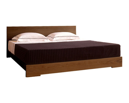 Eco Friendly Furnture and Lighting - This is a straightforward approach to a bed design, with all the essential planar elements, enhanced by the beauty of solid wood. The headboard features the intriguing grain patterns created both by the horizontal lamination of planks and the varied grain of the timber. Available in American black walnut finished with a danish oil or American white oak finished with a danish oil or a white oil.