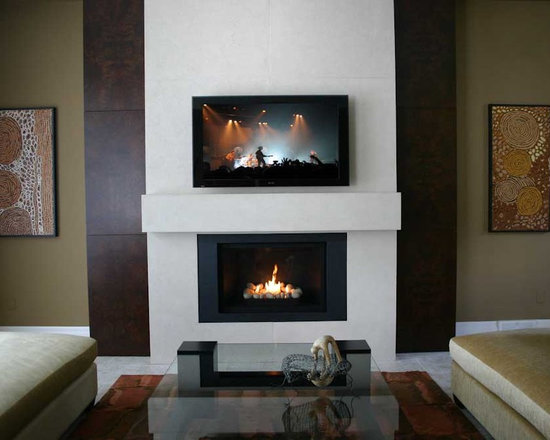 Custom Lightweight Concrete Fireplace Surround - Custom designed fireplace surround built to accomodate television and pre-existing book cases.  Handmade in North America by DEKKO Concrete.  Available for shipment world-wide