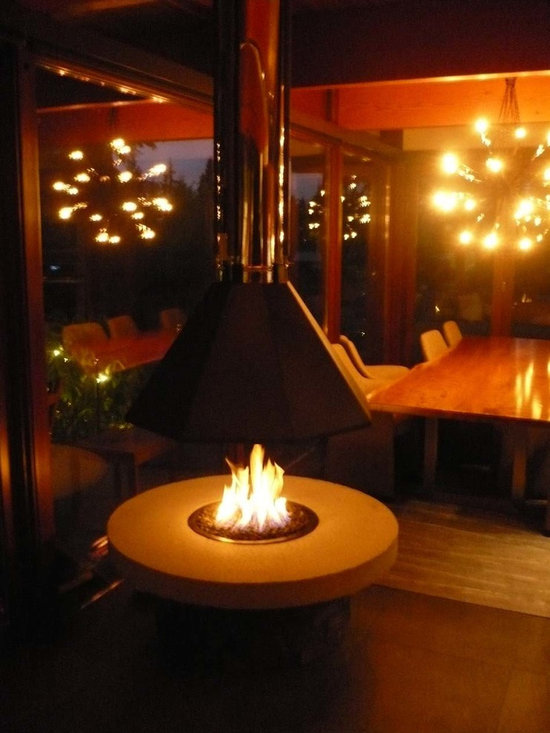 Outdoor Fire Pit with a Suspended Hood -
