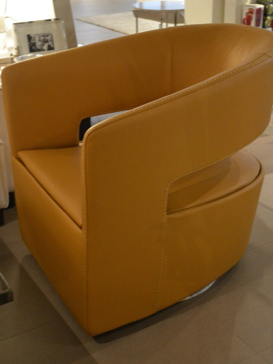 Showroom Pieces - Leather swivel accent chair. For more information about this piece give us a call at (305)576-4566!