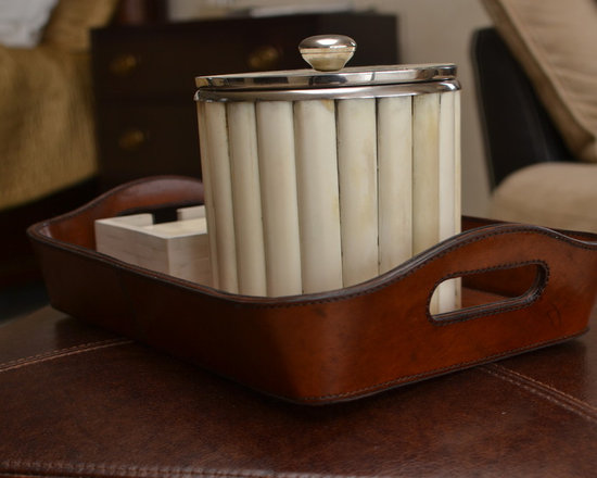 Trasacco 1 - This lovely bone ice bucket coaster set rests in a leather basket atop a leather stool in the bedroom sitting area.