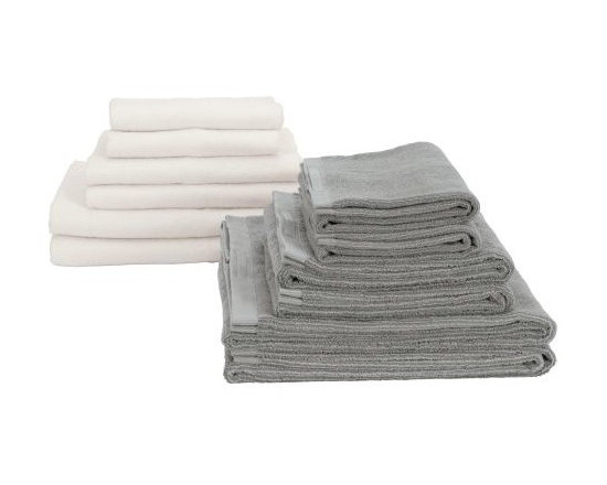 Vipp - Vipp Towels - Set of 6 - Vipp Towels (2004) are woven using a special blend of cotton and rayon fiber that is extracted from natural bamboo. This combination of materials ensures strength and softness, while maximizing water absorption and minimizing dry time. The design keeps the Towels feeling luxurious and fresh after use. The Vipp Towel set includes two small, two medium and two large towels. Each towel has a handy silicone tag that allows it to be hung to dry. Vipp was founded by Holger Nielsen in 1938, after a pedal bin he designed and manufactured for his wife's hair salon quickly gained recognition, and he was flooded with requests for his eminently useful design. Since then, the business has expanded to include a wide assortment of equally well-designed items for the home and bath. Made in China. Each towel has a handy silicone tag that allows it to be hung to dry.  Special blend of cotton and rayon fiber extracted from bamboo dries quickly and contains antimicrobial properties resistant to mildew. The set includes two small, two medium and two large towels.