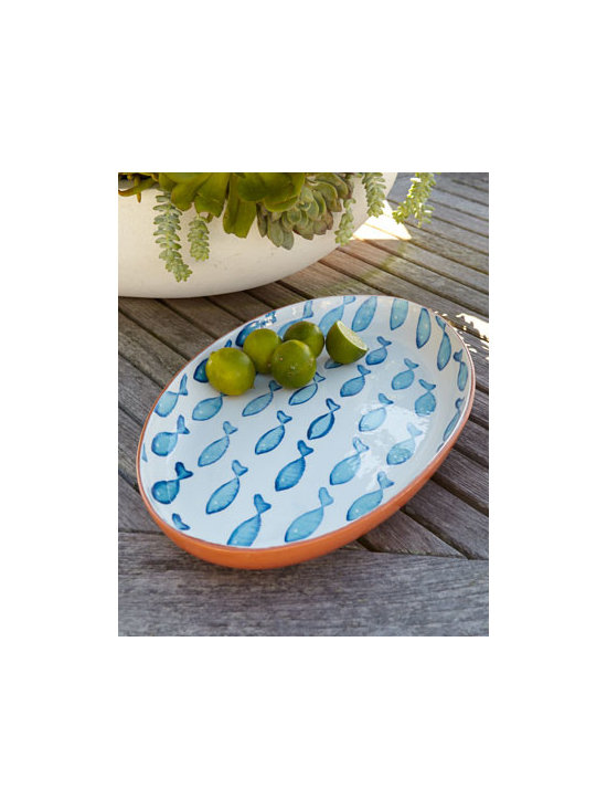 "Horchow - Blue Fish Oval Platter - Whether you're nautically inspired or just fond of fish, this oval platter festooned with a delightful school of blue fish makes a fun addition to table settings. Handcrafted of glazed terra cotta. Hand painted. Microwave and dishwasher safe. 19""W...."