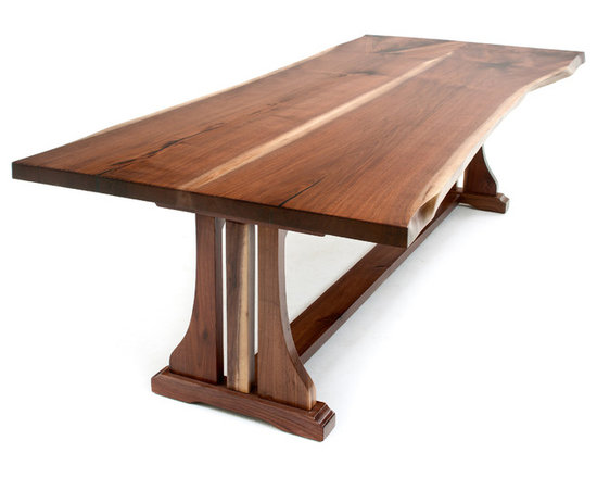 """Woodland Creek Furniture - Live Edge Table with Trestle Base, 108"""" X 48"""" - There is nothing like the beauty of natural wood.  Our workshop is located in northern Michigan, and we are surrounded by some of the finest hardwoods on this earth.  Take a beautiful live edge slab and pair it with a modern stainless steel base and you have a """"soft modern"""" or """"organic modern"""" dining table.  This table design is transitional and will fit nicely into many different decors.  We see our Clients using them in apartments in New York, mountain retreats in the Rockies, and ranches in Texas.  Place modern chairs around a live edge table, and it will fit nicely into a modern home. Place rustic chairs around it, and it will soften a log home – it is truly a transitional design."""