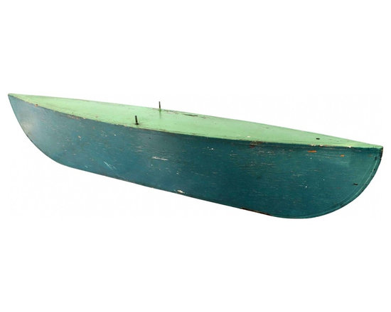 Boat Hull - 1940s three dimensional boat-shaped flotation hull, probably part of a sailing canoe or sailboat, in old two-tone green paint.