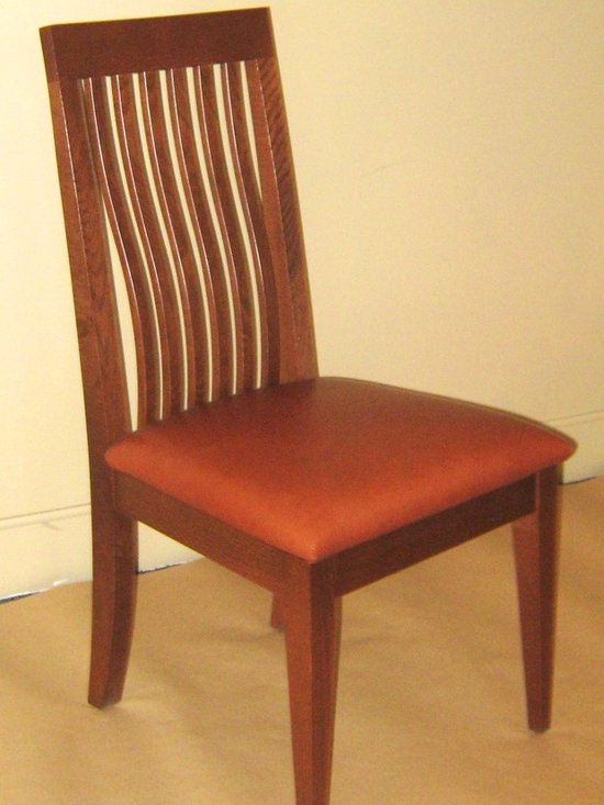 SHAKER SIDE CHAIR - Our dining chairs come in a variety of styles and woods. We have a selection of arm styles to chose from, as well. Many of our chairs come with a carved wood seat option, graded upholstery options, or C.O.M. or C.O.L options as well. Since we build to order, we can adjust the seat height to meet your individual needs.