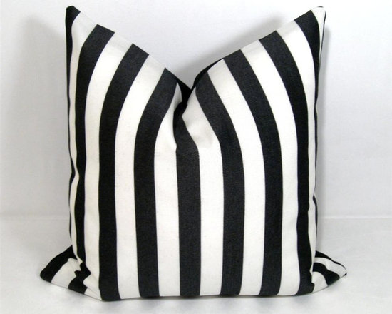 Black White Stripe Outdoor Decor Cushion - Bold black and white striped Outdoor pillow for a space that demands style! Crafted in Sunbrella outdoor fabric for the patio, boat or any low maintenance indoor or outdoor space where style will not be compromised! Zippered closure. Black Sunbrella reverse side.