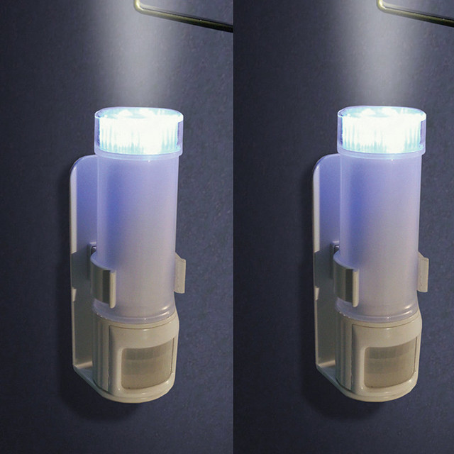 Set of Two Stick on Motion Sensor Lights - traditional - bathroom