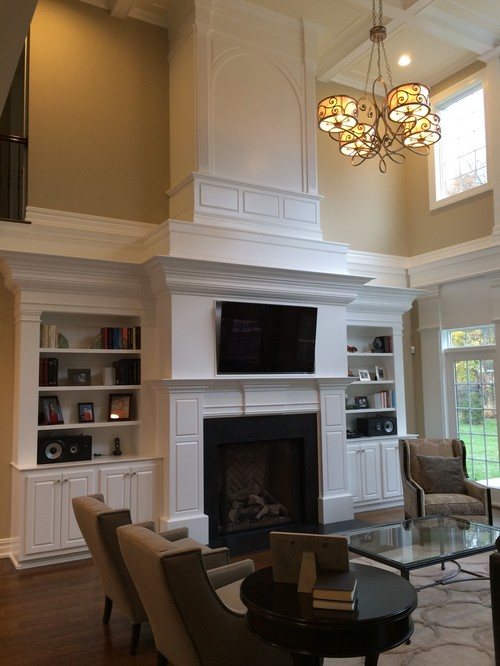 Two Story Fireplace and Built-In Bookshelves