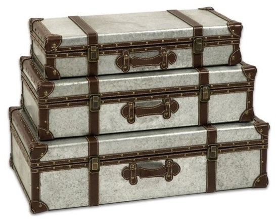 """IMAX CORPORATION - Theodric Galvanized Trunks - Set of 3 - Galvanized metal trunks make a great storage option and add an industrial style that looks great with a variety of decor. Set of 3 in various sizes measuring around 28""""L x 16.75""""W x 8.5""""H each. Shop home furnishings, decor, and accessories from Posh Urban Furnishings. Beautiful, stylish furniture and decor that will brighten your home instantly. Shop modern, traditional, vintage, and world designs."""