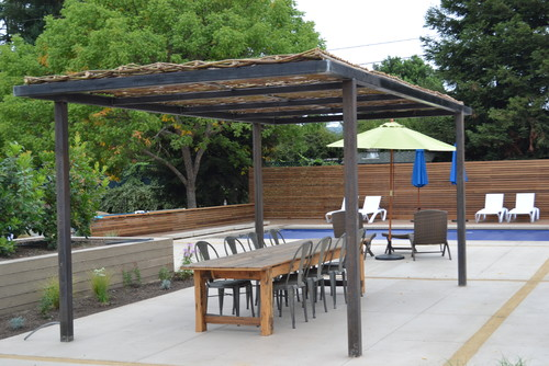 Just completed woven willow canopy with steel frame pergola for Metal frame pergola designs